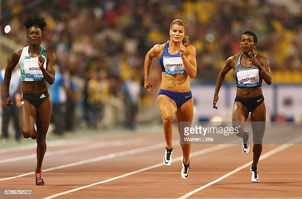 Tori Bowie of the United States Dafne Schippers of the Netherlands and Murielle Ahoure of the Ivory Coast compete in the Women's 100 metres final...