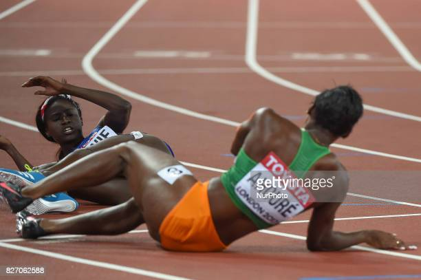 Tori BOWIE USA and Murielle AHOURÉ Cote devour COTE D'IVOIRE after 100 meter finale in London on August 6 2017 at the 2017 IAAF World Championships...