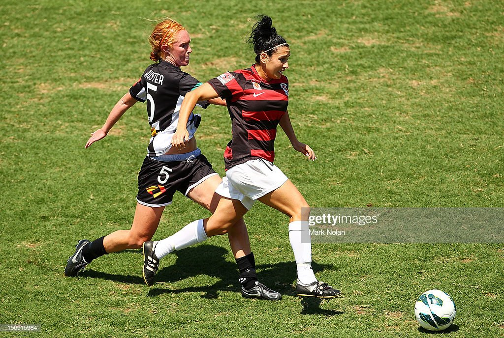 Tori Huster of the Jets and Trudy Camilleri of the Wanderers contest possession during the round six W-League match between the Western Sydney Wanderers and the Newcastle Jets at Campbelltown Sports Stadium on November 25, 2012 in Sydney, Australia.
