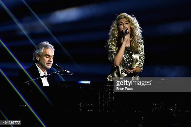 Tori Kelly performs with Andrea Bocelli at the piano on stage during the MTV EMA's 2015 at the Mediolanum Forum on October 25 2015 in Milan Italy