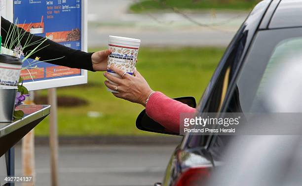 Tori Monagle serves coffee at the Aroma Joes drivethrough in Saco on Monday May 13 2014 The Aroma Joes franchise is growing and expanding into...