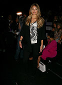 Tori Praver poses next to her front row seat prior to the Zimmermann show at the Overseas Passenger Terminal Circular Quay on day two of Rosemount...