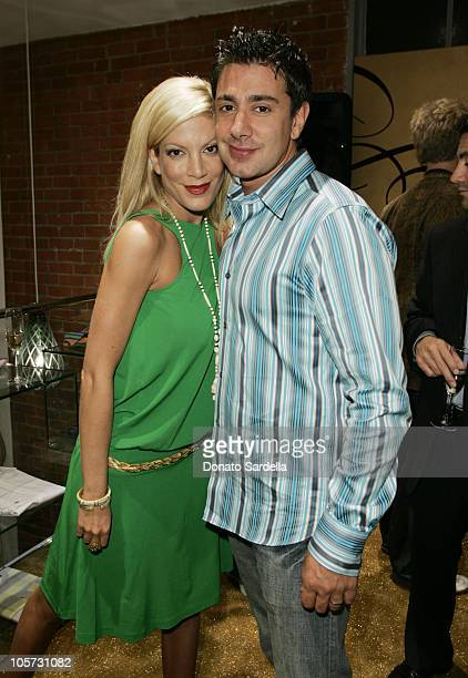 Tori Spelling and Charlie Shanian during Ted Baker London 'Best In Show' Store Opening Red Carpet Arrivals Inside at Ted Baker Store in Los Angeles...
