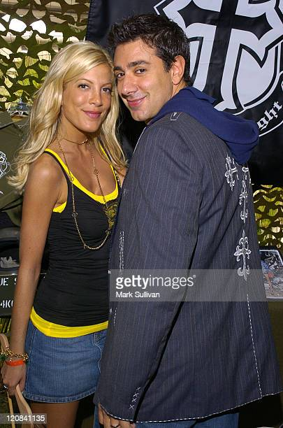 Tori Spelling and Charlie Shanian who is wearing a Jaded by Knight jacket Photo by Mark Sullivan/WireImage for Silver Spoon