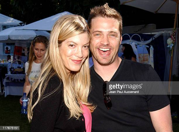 "Tori Spelling and Jason Priestley during 'Silver Spoon Dog and Baby Buffet"" Benefitting Much Love Animal Rescue Day One at Private Residence in..."