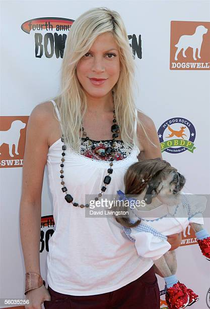 Tori Spelling arrives with her pug Mimi at the Dogswell Dog Treats presents the Fourth Annual Much Love Animal Rescue Bow Wow Ween on October 30 2005...