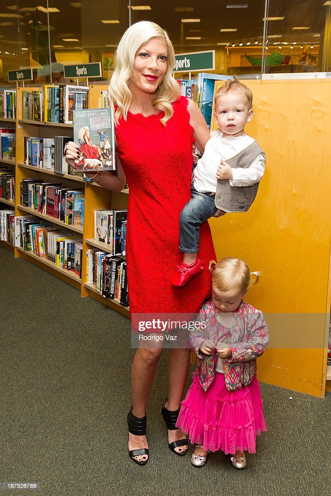 <a gi-track='captionPersonalityLinkClicked' href=/galleries/search?phrase=Tori+Spelling&family=editorial&specificpeople=202560 ng-click='$event.stopPropagation()'>Tori Spelling</a>, Finn McDermott and Hattie McDermott attend as <a gi-track='captionPersonalityLinkClicked' href=/galleries/search?phrase=Tori+Spelling&family=editorial&specificpeople=202560 ng-click='$event.stopPropagation()'>Tori Spelling</a> signs copies of her new book 'Spelling It Like It Is' at Barnes & Noble bookstore at The Grove on November 9, 2013 in Los Angeles, California.