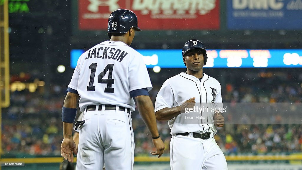Torii Hunter #48 and Austin Jackson #14 of the Detroit Tigers score on a single to centerfield by Andy Dirks (not pictured) during the first inning of the game against the Chicago White Sox at Comerica Park on September 20, 2013 in Detroit, Michigan.