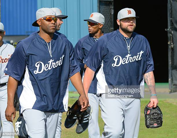 Torii Hunter and Joba Chamberlain of the Detroit Tigers walk onto the field during the spring training workout day at the TigerTown complex on...