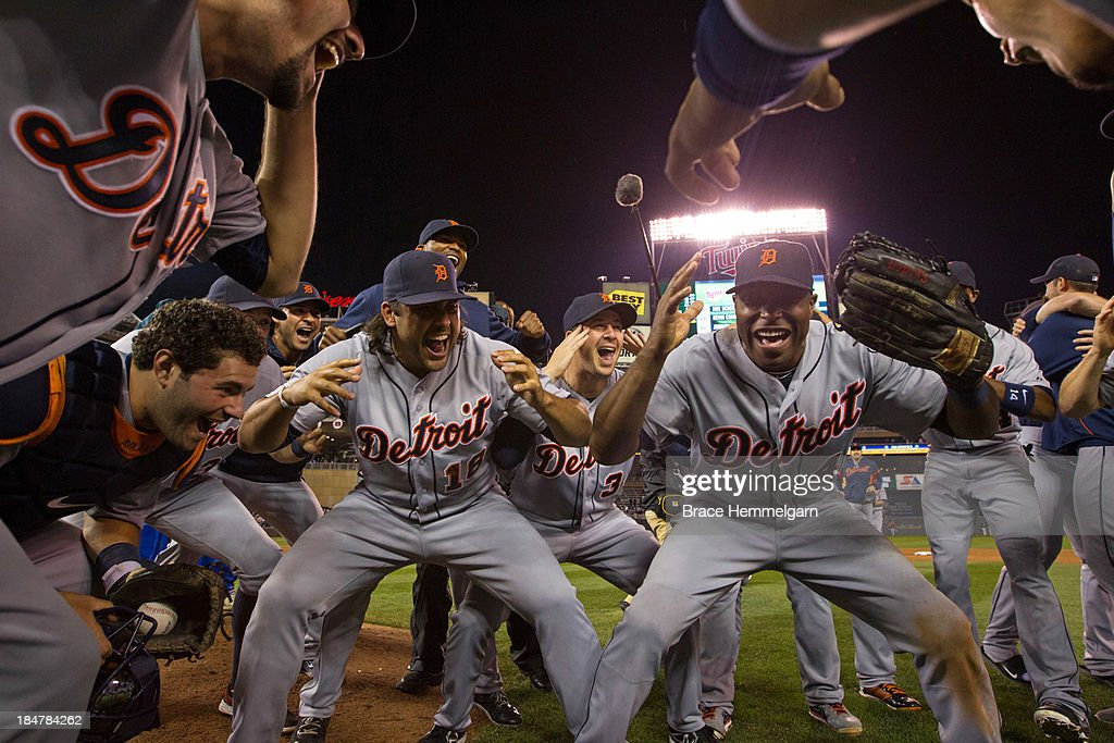 <a gi-track='captionPersonalityLinkClicked' href=/galleries/search?phrase=Torii+Hunter&family=editorial&specificpeople=183408 ng-click='$event.stopPropagation()'>Torii Hunter</a> #48 and Matt Tuiasosopo #18 of the Detroit Tigers and teammates celebrate the American League Central division championship following the game against the Minnesota Twins on September 25, 2013 at Target Field in Minneapolis, Minnesota. The Tigers defeated the Twins 1-0.