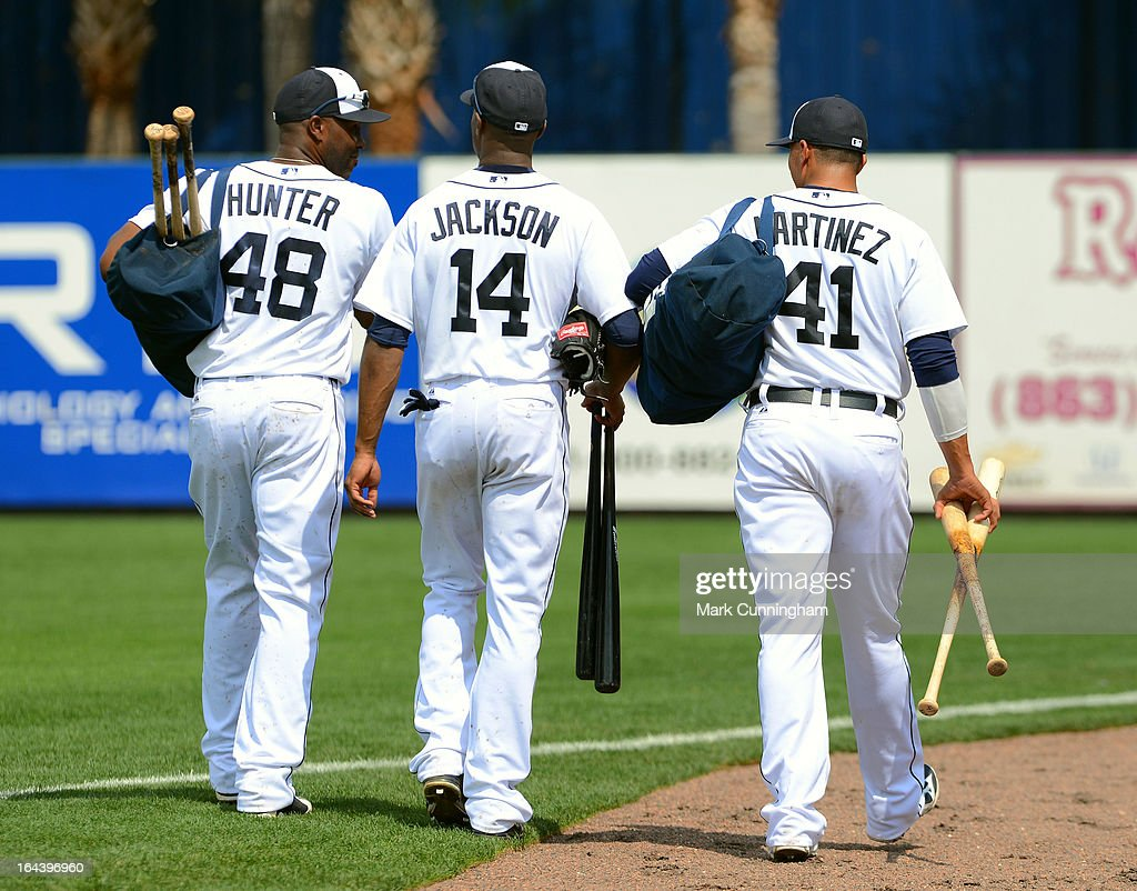 Torii Hunter #48, Austin Jackson #14 and Victor Martinez #41 of the Detroit Tigers walk to the clubhouse during the spring training game against the New York Yankees at Joker Marchant Stadium on March 23, 2013 in Lakeland, Florida. The Tigers defeated the Yankees 10-6.