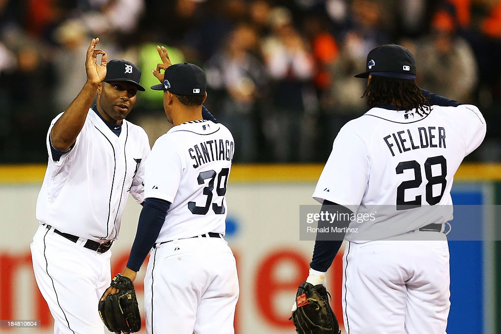 Torii Hunter #48 celebrates with Ramon Santiago #39 and Prince Fielder #28 of the Detroit Tigers after they defeated the Boston Red Sox 7 to 3 in Game Four of the American League Championship Series at Comerica Park on October 16, 2013 in Detroit, Michigan.