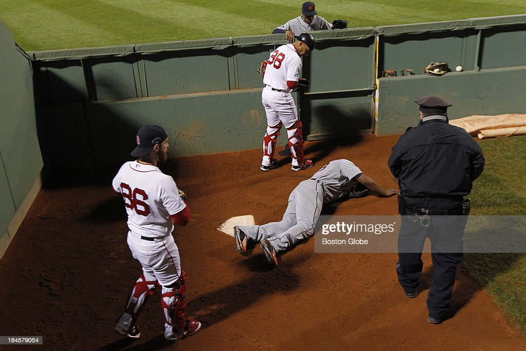 Torii Hunter lands in the Red Sox bullpen chasing David Ortiz's grand slam to tie the game in the eighth inning. The Boston Red Sox hosted the Detroit Tigers in Game Two of the American League Championship Series at Fenway Park.