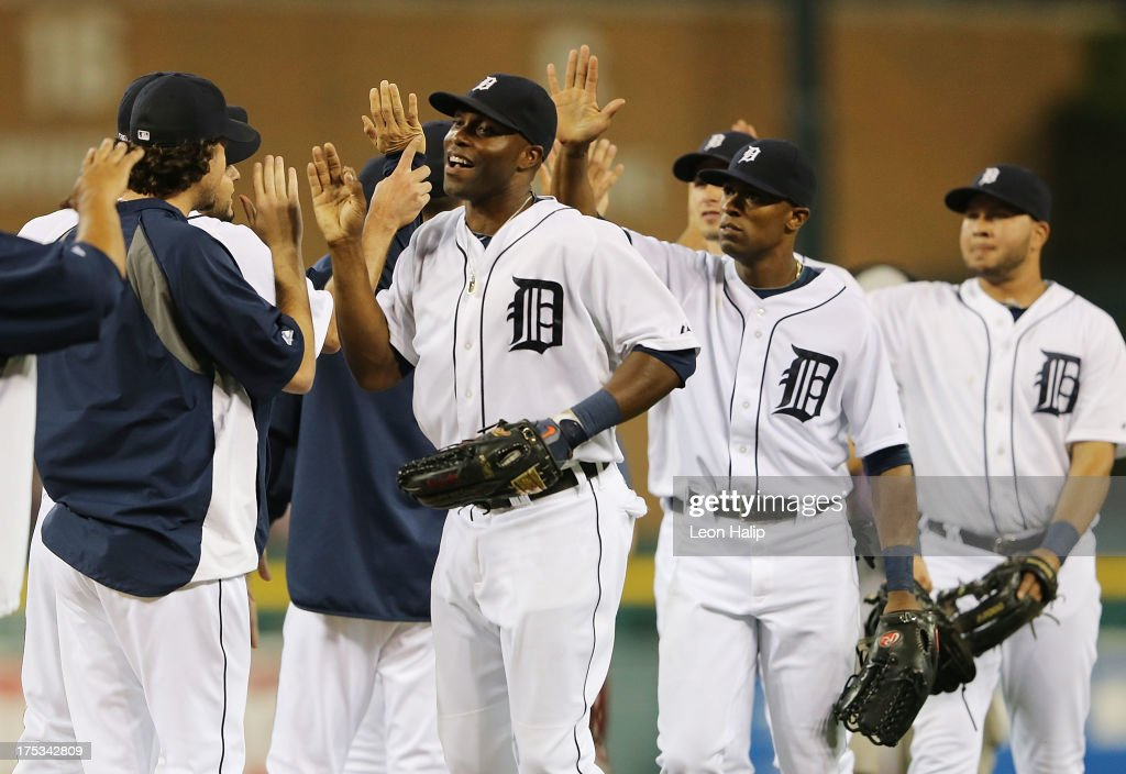 <a gi-track='captionPersonalityLinkClicked' href=/galleries/search?phrase=Torii+Hunter&family=editorial&specificpeople=183408 ng-click='$event.stopPropagation()'>Torii Hunter</a> #48 of the Detroit Tigers celebrates a win over the Chicago White Sox with his teammates at Comerica Park on August 2, 2013 in Detroit, Michigan. The Tigers defeated the White Sox 2-1.