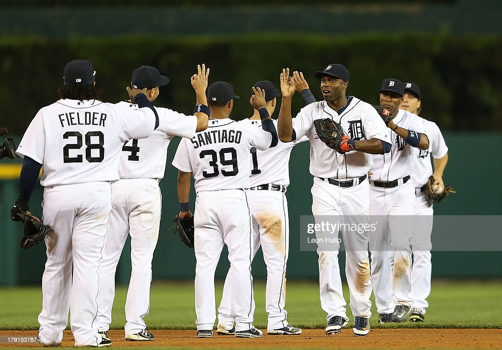 <a gi-track='captionPersonalityLinkClicked' href=/galleries/search?phrase=Torii+Hunter&family=editorial&specificpeople=183408 ng-click='$event.stopPropagation()'>Torii Hunter</a> #48 of the Detroit Tigers celebrates a win over the Cleveland Indians with his teammates after the game at Comerica Park on August 31, 2013 in Detroit, Michigan. The Tigers defeated the Indians 10-5.