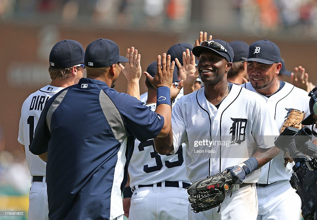 <a gi-track='captionPersonalityLinkClicked' href=/galleries/search?phrase=Torii+Hunter&family=editorial&specificpeople=183408 ng-click='$event.stopPropagation()'>Torii Hunter</a> #48 of the Detroit Tigers celebrates a win over the Texas Rangers with pitching coach Jeff Jones after the game against the Texas Rangers at Comerica Park on July 14, 2013 in Detroit, Michigan. The Tigers defeated the Rangers 5-0.