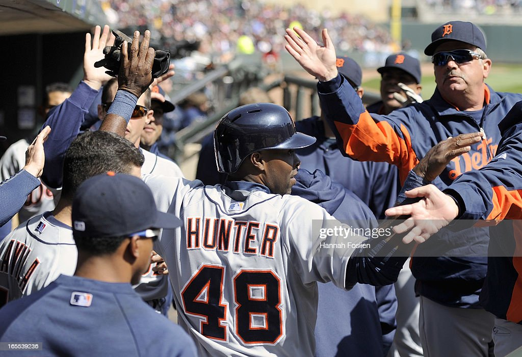 <a gi-track='captionPersonalityLinkClicked' href=/galleries/search?phrase=Torii+Hunter&family=editorial&specificpeople=183408 ng-click='$event.stopPropagation()'>Torii Hunter</a> #48 of the Detroit Tigers celebrates scoring a run against the Minnesota Twins during the third inning of the game on April 4, 2013 at Target Field in Minneapolis, Minnesota.