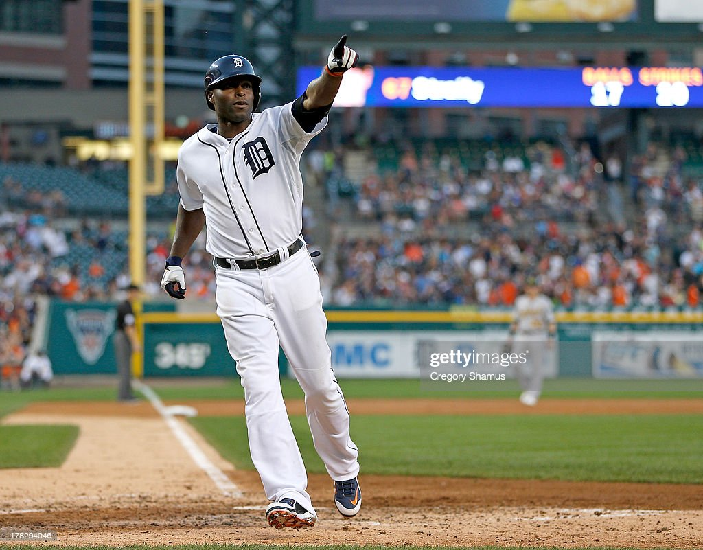 <a gi-track='captionPersonalityLinkClicked' href=/galleries/search?phrase=Torii+Hunter&family=editorial&specificpeople=183408 ng-click='$event.stopPropagation()'>Torii Hunter</a> #48 of the Detroit Tigers celebrates scoring a run in the third inning while playing the Oakland Athletics at Comerica Park on August 28, 2013 in Detroit, Michigan.