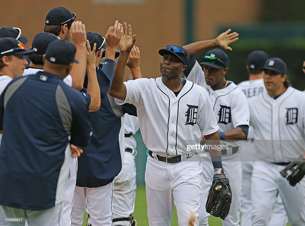 <a gi-track='captionPersonalityLinkClicked' href=/galleries/search?phrase=Torii+Hunter&family=editorial&specificpeople=183408 ng-click='$event.stopPropagation()'>Torii Hunter</a> #48 of the Detroit Tigers celebrates with his teammates after defeating the Washington Nationals at Comerica Park on July 31, 2013 in Detroit, Michigan. The Tigers defeated the Nationals 11-1.