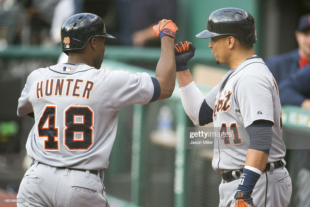 <a gi-track='captionPersonalityLinkClicked' href=/galleries/search?phrase=Torii+Hunter&family=editorial&specificpeople=183408 ng-click='$event.stopPropagation()'>Torii Hunter</a> #48 of the Detroit Tigers celebrates with Victor Martinez #41 after Hunter hit a solo home run during the first inning against the Cleveland Indians at Progressive Field on May 20, 2014 in Cleveland, Ohio.