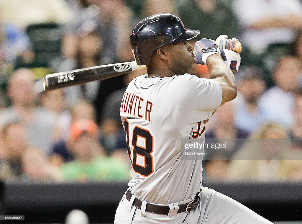 <a gi-track='captionPersonalityLinkClicked' href=/galleries/search?phrase=Torii+Hunter&family=editorial&specificpeople=183408 ng-click='$event.stopPropagation()'>Torii Hunter</a> #48 of the Detroit Tigers doubles in the eighth inning against the Houston Astros at Minute Maid Park on May 4, 2013 in Houston, Texas.