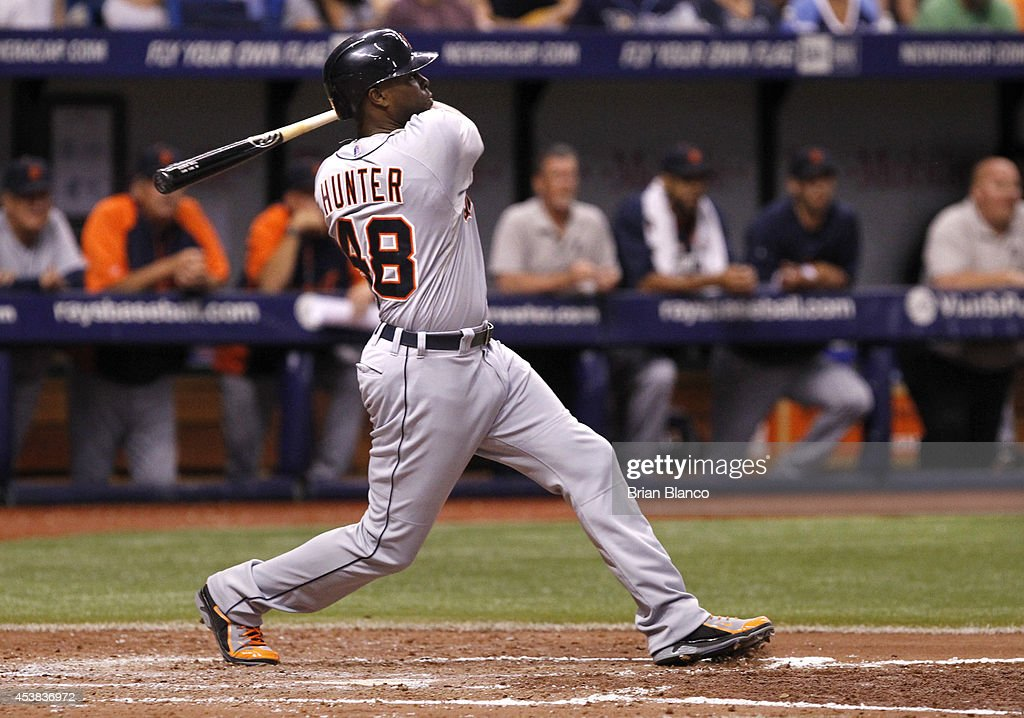 <a gi-track='captionPersonalityLinkClicked' href=/galleries/search?phrase=Torii+Hunter&family=editorial&specificpeople=183408 ng-click='$event.stopPropagation()'>Torii Hunter</a> #48 of the Detroit Tigers grounds into the fielder's choice to score Andrew Romine during the fifth inning of a game against the Tampa Bay Rays on August 19, 2014 at Tropicana Field in St. Petersburg, Florida.
