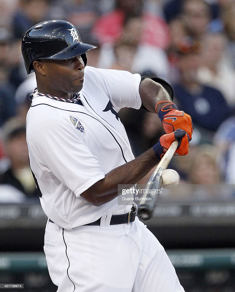<a gi-track='captionPersonalityLinkClicked' href=/galleries/search?phrase=Torii+Hunter&family=editorial&specificpeople=183408 ng-click='$event.stopPropagation()'>Torii Hunter</a> #48 of the Detroit Tigers hits a grounder to third base and is thrown out but Victor Martinez scores from third on the play during the fourth inning of a game against the Tampa Bay Rays at Comerica Park on July 4, 2014 in Detroit, Michigan.