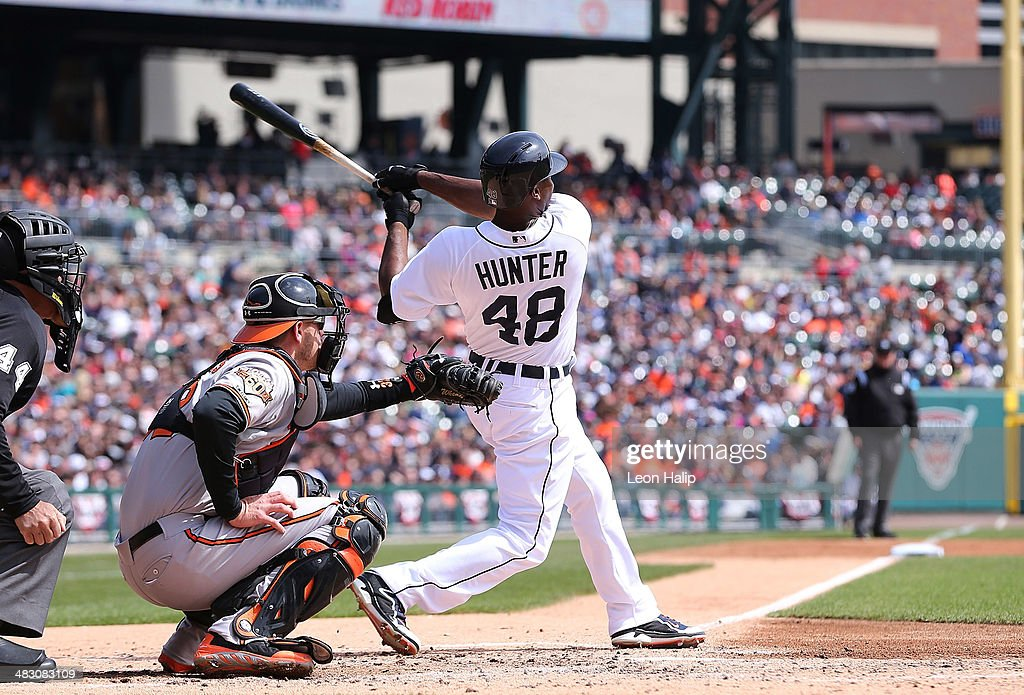 Torii Hunter #48 of the Detroit Tigers hits a solo home run to left field during the fourth inning of the game against the Baltimore Orioles at Comerica Park on April 6, 2014 in Detroit, Michigan.