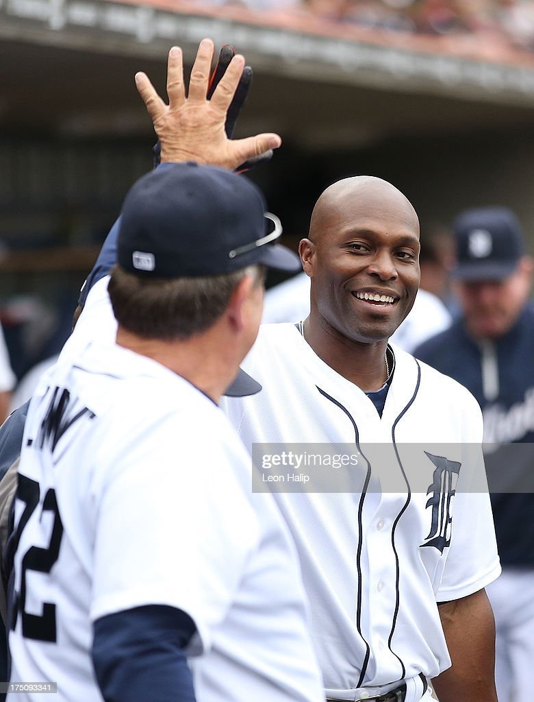 <a gi-track='captionPersonalityLinkClicked' href=/galleries/search?phrase=Torii+Hunter&family=editorial&specificpeople=183408 ng-click='$event.stopPropagation()'>Torii Hunter</a> #48 of the Detroit Tigers is congratulated by bench coach <a gi-track='captionPersonalityLinkClicked' href=/galleries/search?phrase=Gene+Lamont&family=editorial&specificpeople=547263 ng-click='$event.stopPropagation()'>Gene Lamont</a> #22 after nearly hitting for the cycle during the game against the Washington Nationals at Comerica Park on July 31, 2013 in Detroit, Michigan. The Tigers defeated the Nationals 11-1.
