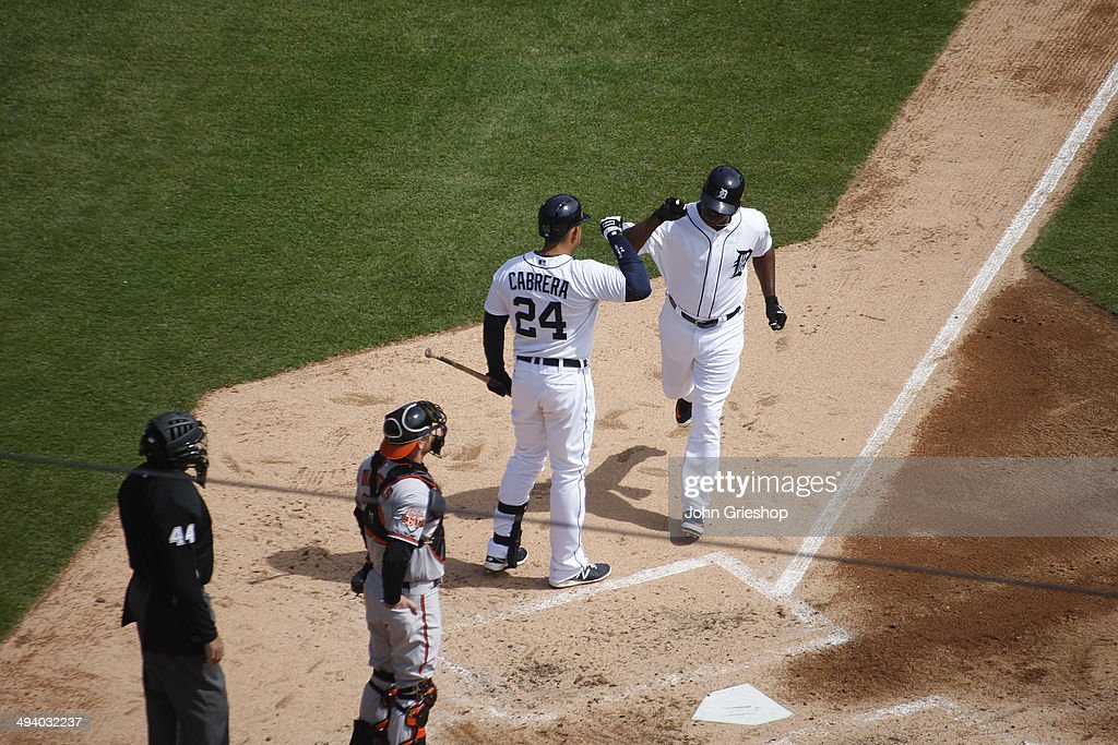 <a gi-track='captionPersonalityLinkClicked' href=/galleries/search?phrase=Torii+Hunter&family=editorial&specificpeople=183408 ng-click='$event.stopPropagation()'>Torii Hunter</a> of the Detroit Tigers is greeted by teammate <a gi-track='captionPersonalityLinkClicked' href=/galleries/search?phrase=Miguel+Cabrera&family=editorial&specificpeople=202141 ng-click='$event.stopPropagation()'>Miguel Cabrera</a> #24 after hitting a solo home run in the bottom of the fourth inning during the game against the Baltimore Orioles at Comerica Park on Sunday, April 6, 2014 in Detroit, Michigan. The Orioles defeated the Tigers 3-1.
