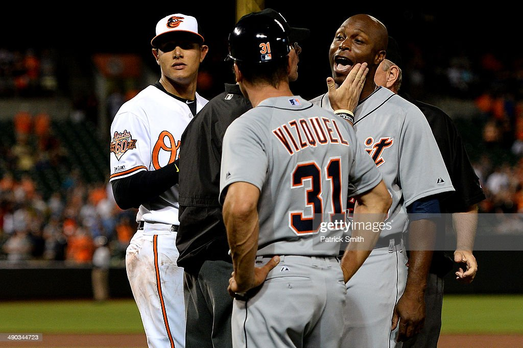 <a gi-track='captionPersonalityLinkClicked' href=/galleries/search?phrase=Torii+Hunter&family=editorial&specificpeople=183408 ng-click='$event.stopPropagation()'>Torii Hunter</a> #48 of the Detroit Tigers is held back after being hit by a pitch by pitcher Bud Norris #25 of the Baltimore Orioles in the eighth inning at Oriole Park at Camden Yards on May 12, 2014 in Baltimore, Maryland. The Detroit Tigers won, 4-1.