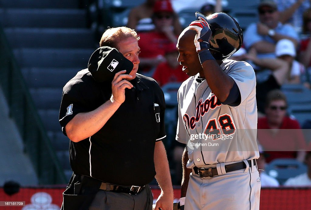 <a gi-track='captionPersonalityLinkClicked' href=/galleries/search?phrase=Torii+Hunter&family=editorial&specificpeople=183408 ng-click='$event.stopPropagation()'>Torii Hunter</a> #48 of the Detroit Tigers questions home plate umpire Bruce Dreckman after striking out to end the 11th inning against the Los Angeles Angels of Anaheim at Angel Stadium of Anaheim on April 21, 2013 in Anaheim, California.