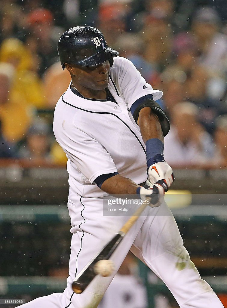 Torii Hunter #48 of the Detroit Tigers singles to right field, scoring Andy Dirks and Alex Avila during the third inning of the game against the Chicago White Sox at Comerica Park on September 20, 2013 in Detroit, Michigan.