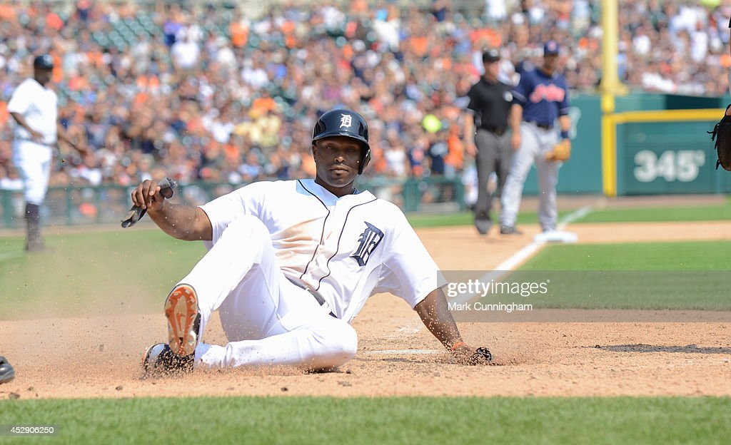 <a gi-track='captionPersonalityLinkClicked' href=/galleries/search?phrase=Torii+Hunter&family=editorial&specificpeople=183408 ng-click='$event.stopPropagation()'>Torii Hunter</a> #48 of the Detroit Tigers slides safely into home during the game against the Cleveland Indians at Comerica Park on July 20, 2014 in Detroit, Michigan. The Tigers defeated the Indians 5-1.