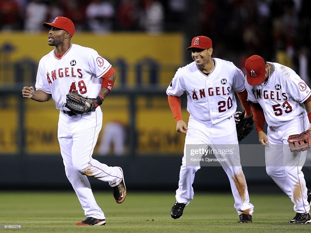 f08a06f0e67 ... Torii Hunter 48 of the Los Angeles Angels of Anaheim celebrates with  teammates Juan Rivera ...