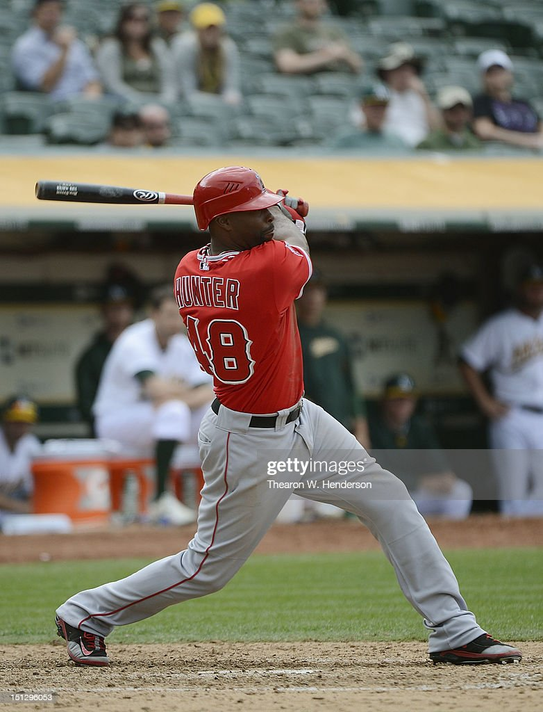 <a gi-track='captionPersonalityLinkClicked' href=/galleries/search?phrase=Torii+Hunter&family=editorial&specificpeople=183408 ng-click='$event.stopPropagation()'>Torii Hunter</a> #48 of the Los Angeles Angels of Anaheim hits a two run single with the bases loaded in the ninth inning against the Oakland Athletics at O.co Coliseum on September 5, 2012 in Oakland, California. The Angels won the game 7-1.