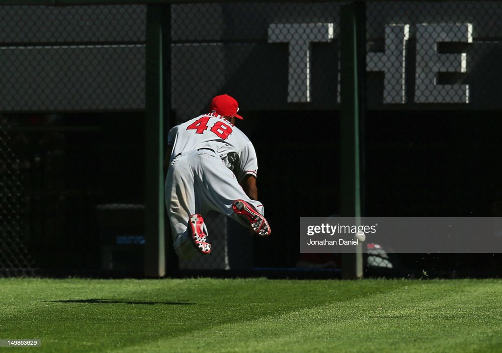 196e4355434 ... Torii Hunter 48 of the Los Angeles Angels of Anaheim tries but fails to  make ...