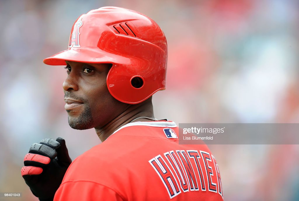 Torii Hunter #48 of the Los Angeles Angels of Anaheim waits on deck during the game against the Oakland Athletics at Angel Stadium of Anaheim on April 11, 2010 in Anaheim, California.