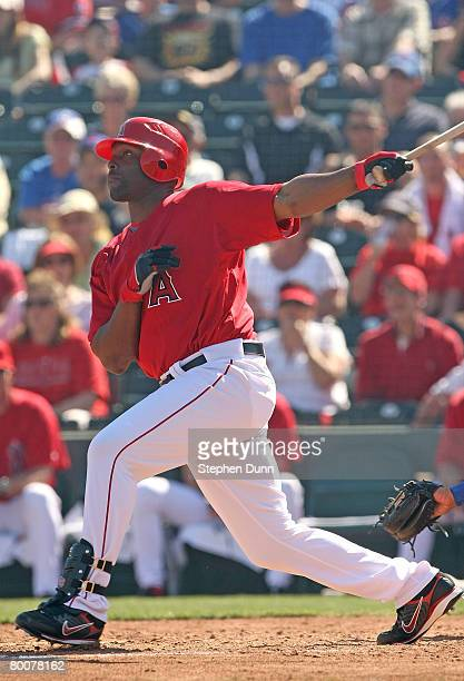 Torii Hunter of the Los Angels of Anaheim hits a three run home run in the third inning against the Chicago Cubs on March 1 2008 at Tempe Diablo...