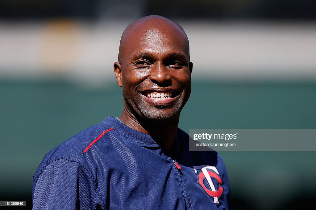 <a gi-track='captionPersonalityLinkClicked' href=/galleries/search?phrase=Torii+Hunter&family=editorial&specificpeople=183408 ng-click='$event.stopPropagation()'>Torii Hunter</a> #48 of the Minnesota Twins laughs with teammates during batting practice before the game against the Oakland Athletics at O.co Coliseum on July 18, 2015 in Oakland, California.