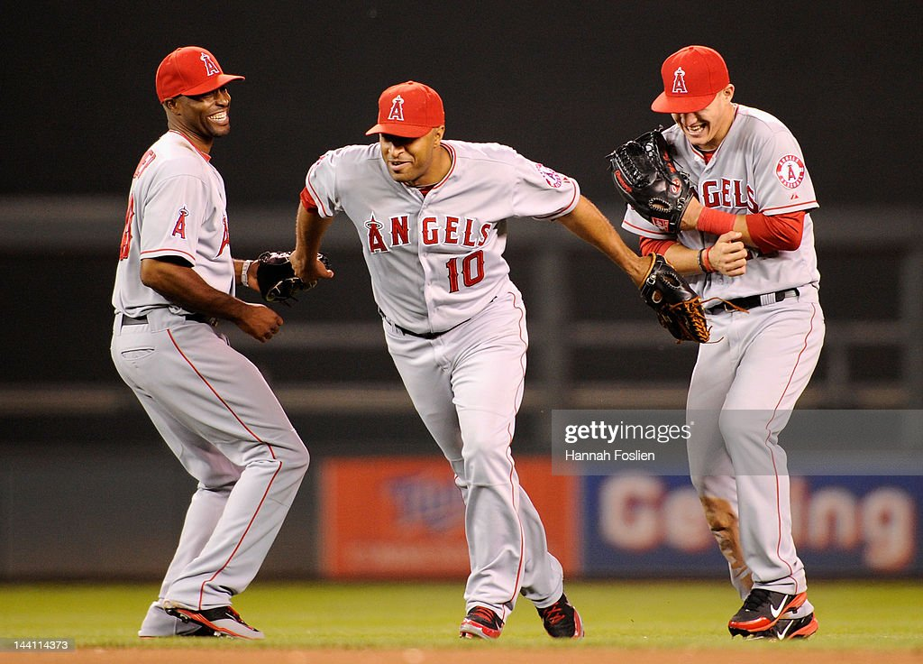 Torii Hunter Vernon Wells and Mike Trout of the Los Angeles Angels of Anaheim celebrate a win against the Minnesota Twins on May 9 2012 at Target...