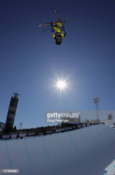 Torin YaterWallace soars above the pipe as he warms up prior to the finals of the men's ski superpipe during Winter X Games 2012 at Buttermilk...