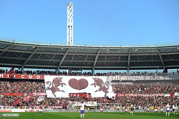 Torino FC fans display a giant banner during the Serie A match between Torino FC and ACF Fiorentina at Stadio Olimpico di Torino on January 12 2014...