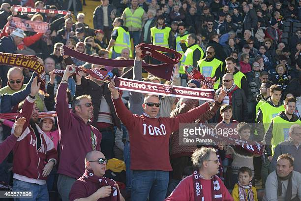 Torino FC fans shows their support during the Serie A match between Udinese Calcio and Torino FC at Stadio Friuli on March 8 2015 in Udine Italy
