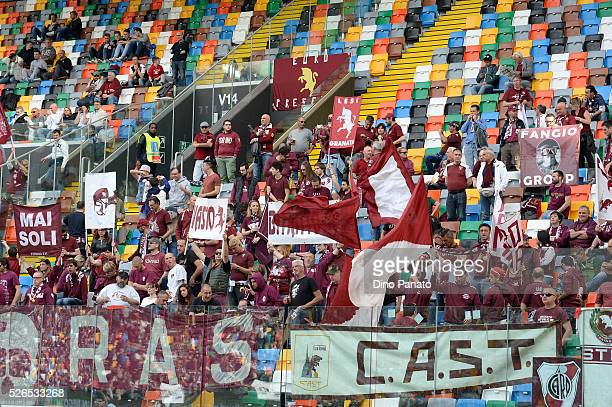Torino FC fans shows their support during the Serie A match between Udinese Calcio and Torino FC at Dacia Arena on April 30 2016 in Udine Italy