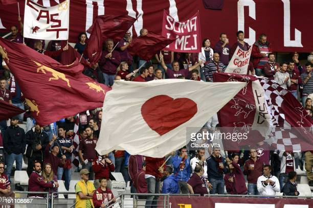 Torino FC fans wave flags during the Serie A match between Torino FC v Pescara Calcio at Stadio Olimpico di Torino on September 1 2012 in Turin Italy