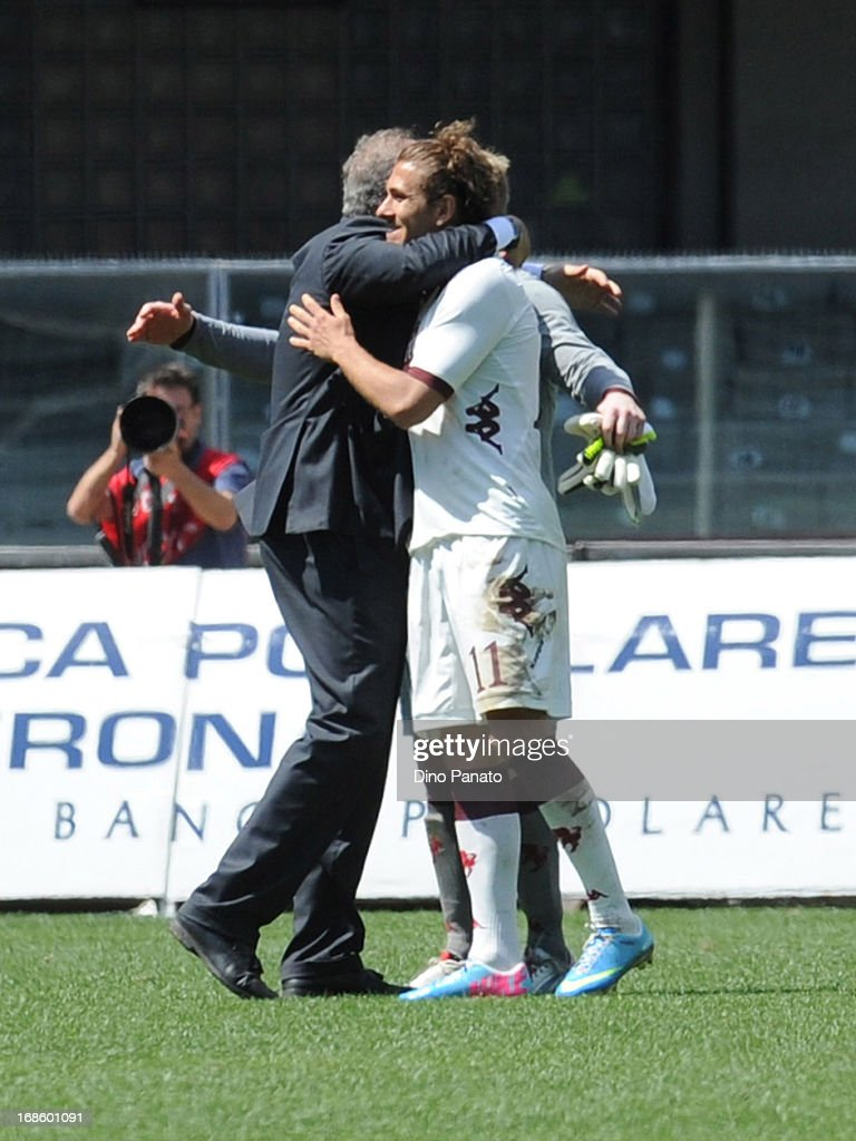 Torino FC head cach <a gi-track='captionPersonalityLinkClicked' href=/galleries/search?phrase=Giampiero+Ventura&family=editorial&specificpeople=3648341 ng-click='$event.stopPropagation()'>Giampiero Ventura</a> (L) celebrates with Alessio Cerci (R) after the Serie A match between AC Chievo Verona and Torino FC at Stadio Marc'Antonio Bentegodi on May 12, 2013 in Verona, Italy.