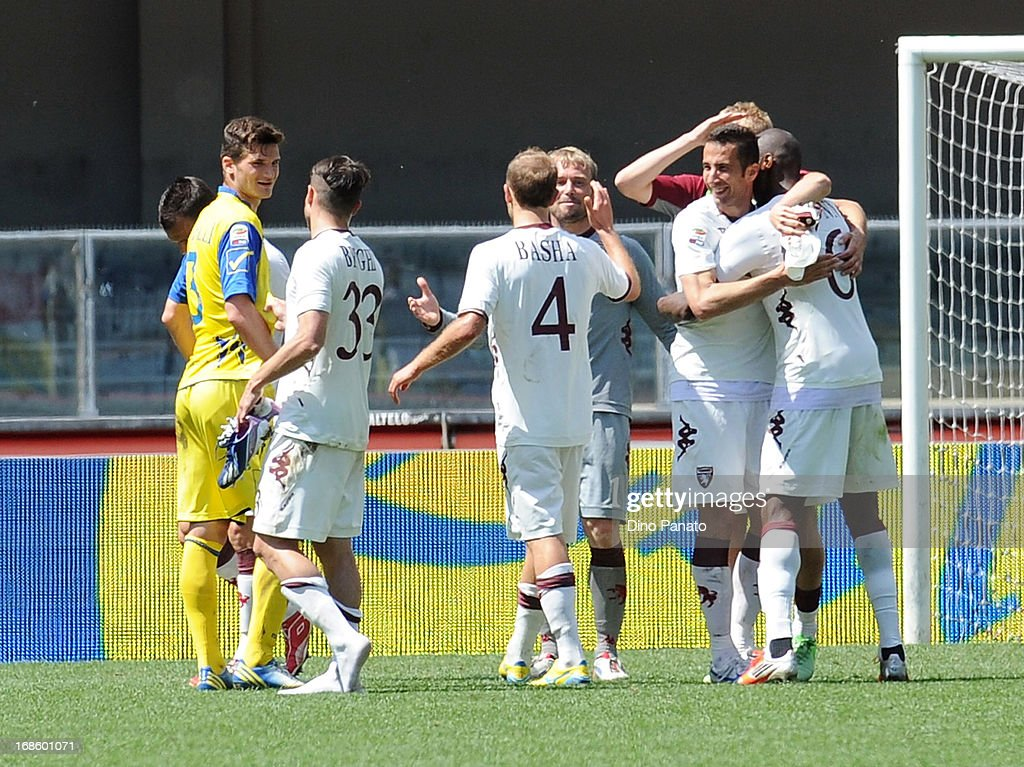Torino FC players celebrate after the Serie A match between AC Chievo Verona and Torino FC at Stadio Marc'Antonio Bentegodi on May 12, 2013 in Verona, Italy.