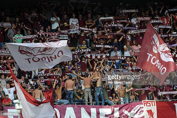 Torino FC supporters cheer during the Serie A match between Torino FC and ACF Fiorentina at Stadio Olimpico di Torino on September 28 2014 in Turin...