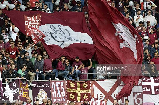 Torino FC supporters wave flags during the Serie A match between Torino FC v Pescara Calcio at Stadio Olimpico di Torino on September 1 2012 in Turin...